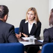 Image of a woman talking on a business environment